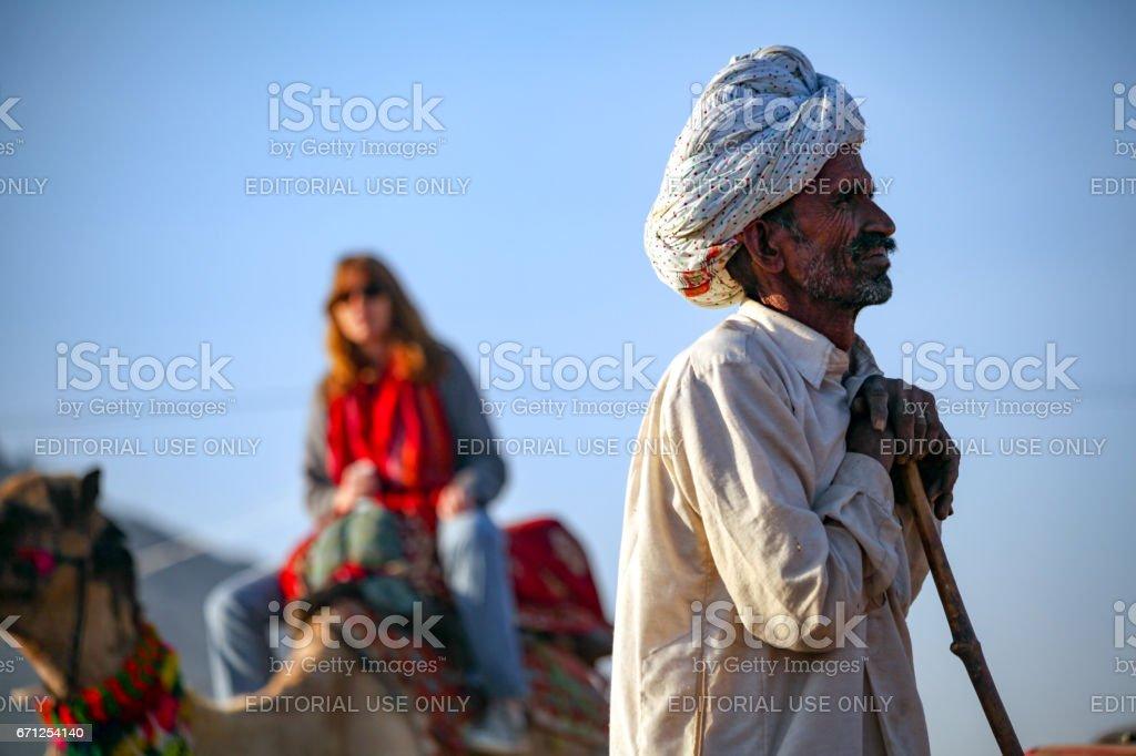 A senior man with white turban at Pushkar Camel Fair stock photo