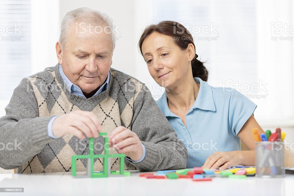 Senior man with wooden blocks royalty-free stock photo