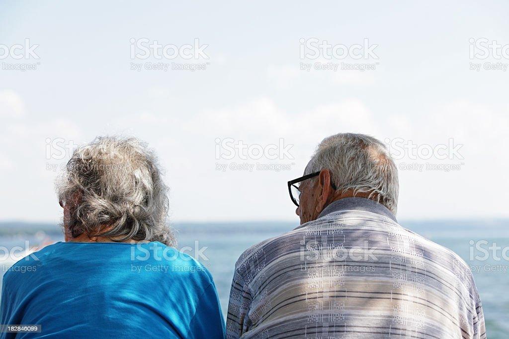 Senior Man Woman Couple Watching Lake Water Activities royalty-free stock photo
