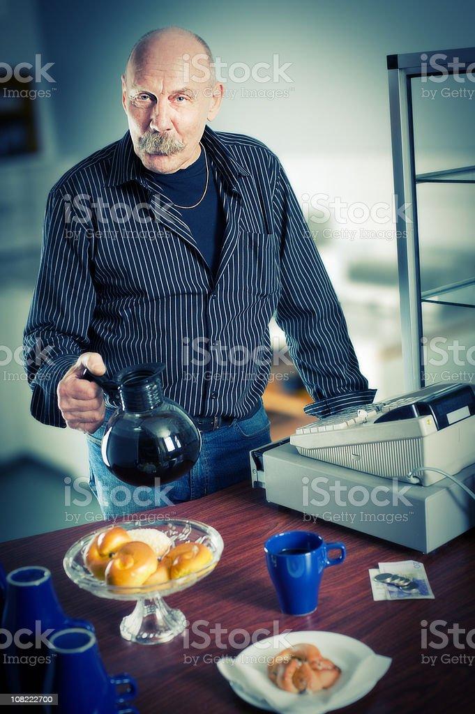 Senior Man Working in Cafe royalty-free stock photo