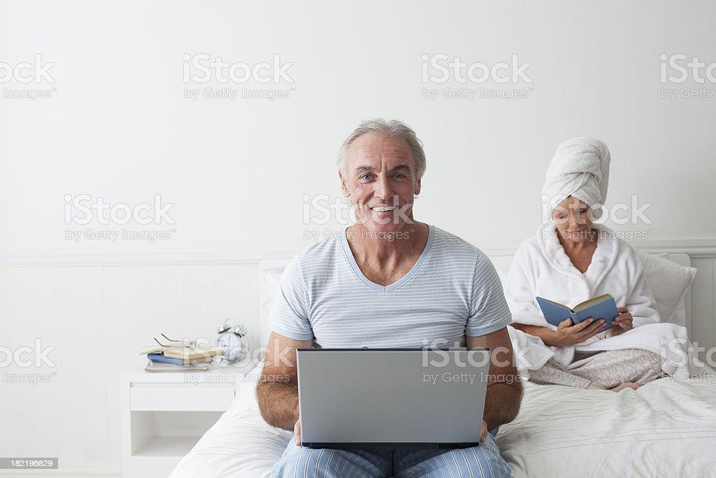 Senior man working on laptop royalty-free stock photo