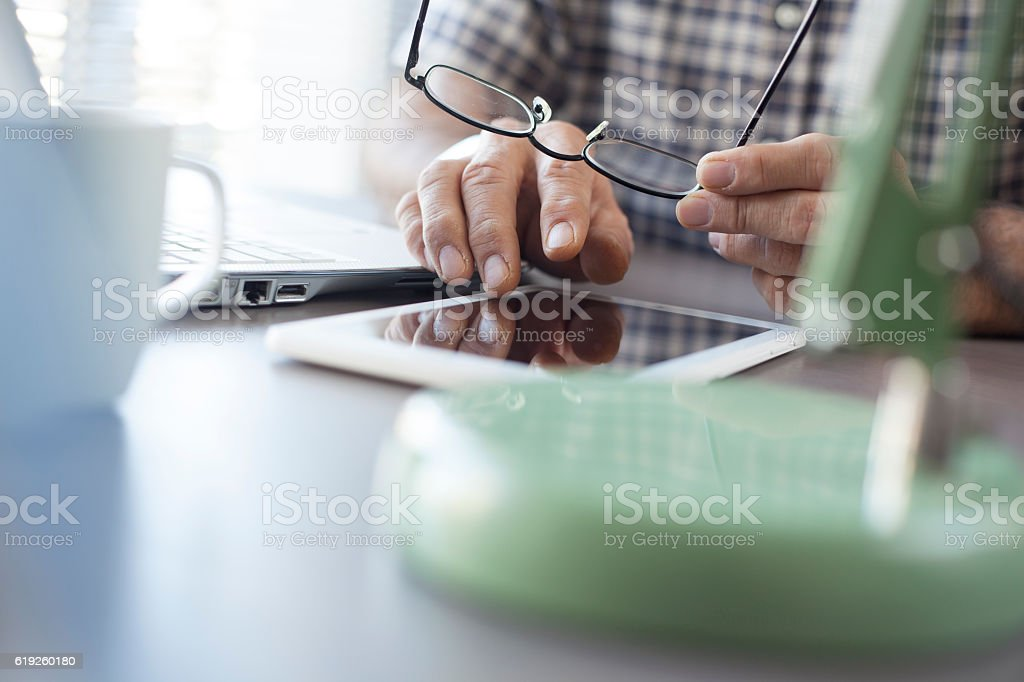 Senior man working on tablet stock photo
