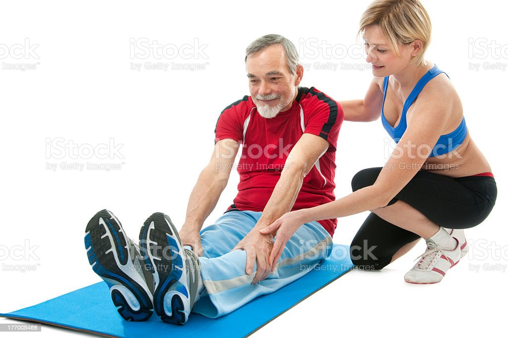 Senior man working out with female trainer royalty-free stock photo