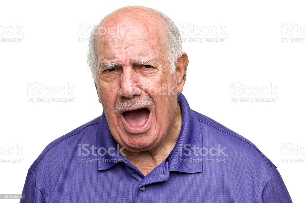 Senior man yelling and looking angry stock photo