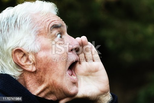 661896674istockphoto Senior man yells outdoors 1170741984