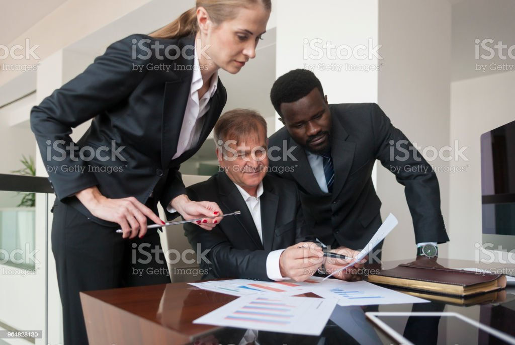 Senior Manager giving direction to his personel royalty-free stock photo