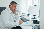 Senior manager looking at data