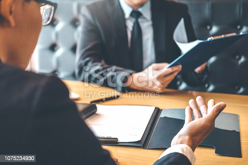 istock Senior manager reading a resume during a job interview employee young man meeting Applicant and recruitment concept 1075234930