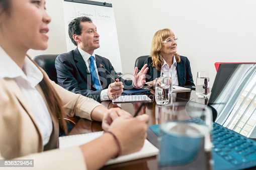 istock Senior managers sitting down during an important interactive mee 836329454