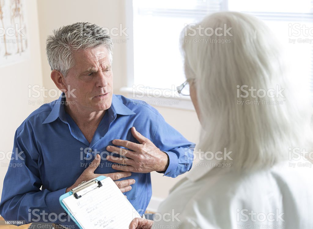 Senior Man's Doctor Visit stock photo