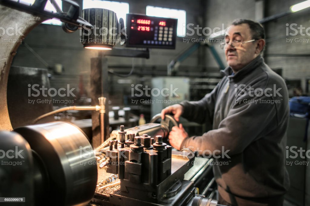 Senior, manual worker stock photo