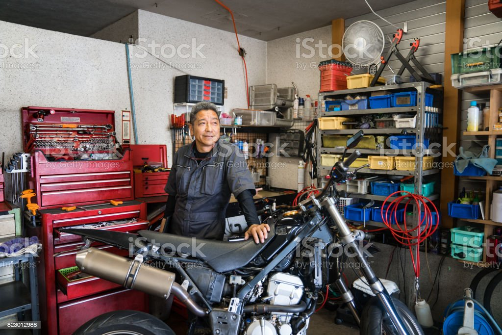 Royalty Free Asian Mechanic Pictures, Images and Stock Photos - iStock