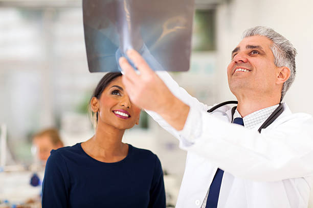 senior medical doctor examining patients x-ray stock photo