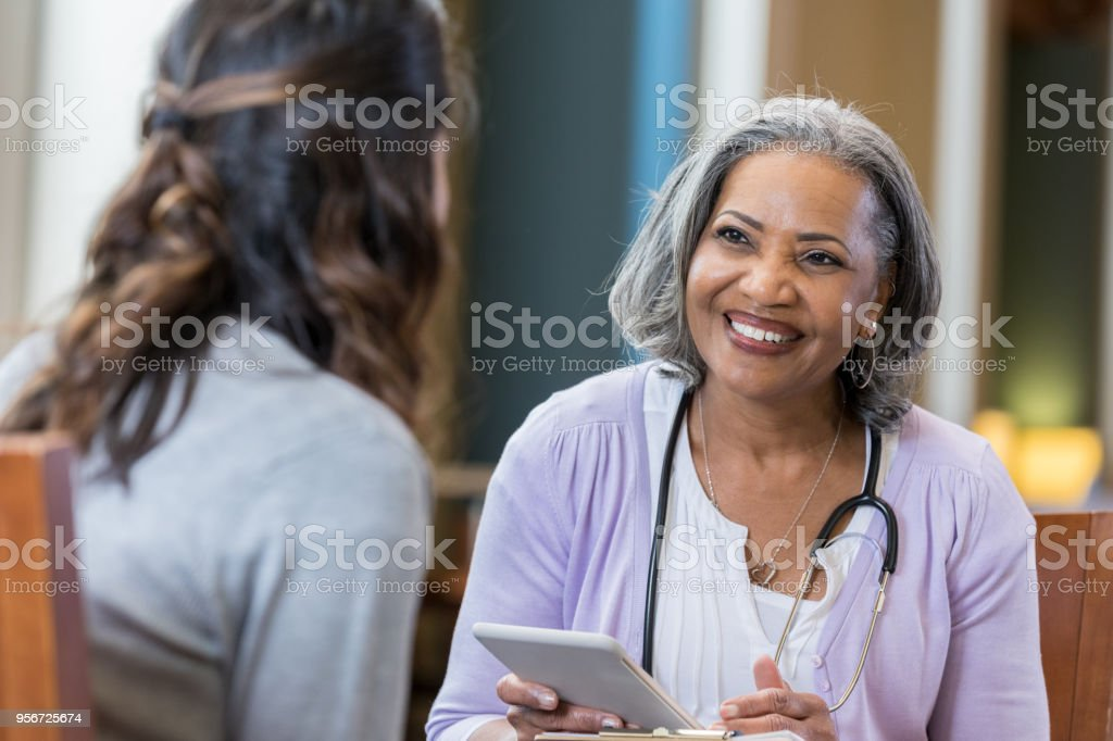 Senior medical professional interviews potential new hire stock photo