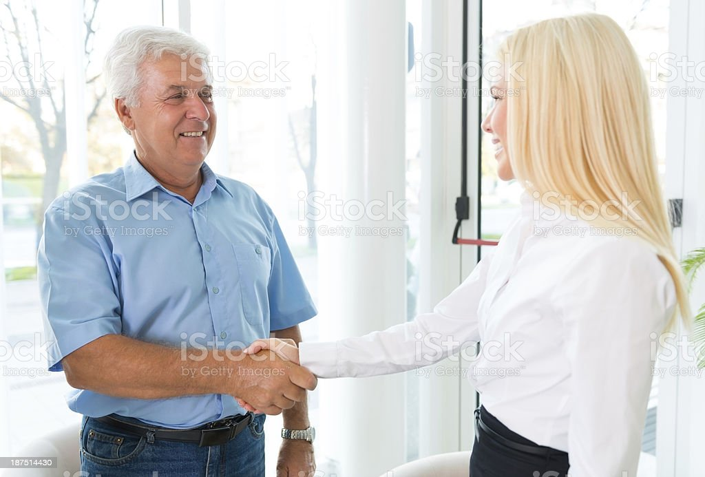 Senior men Shaking Hand With Insurance Agent royalty-free stock photo
