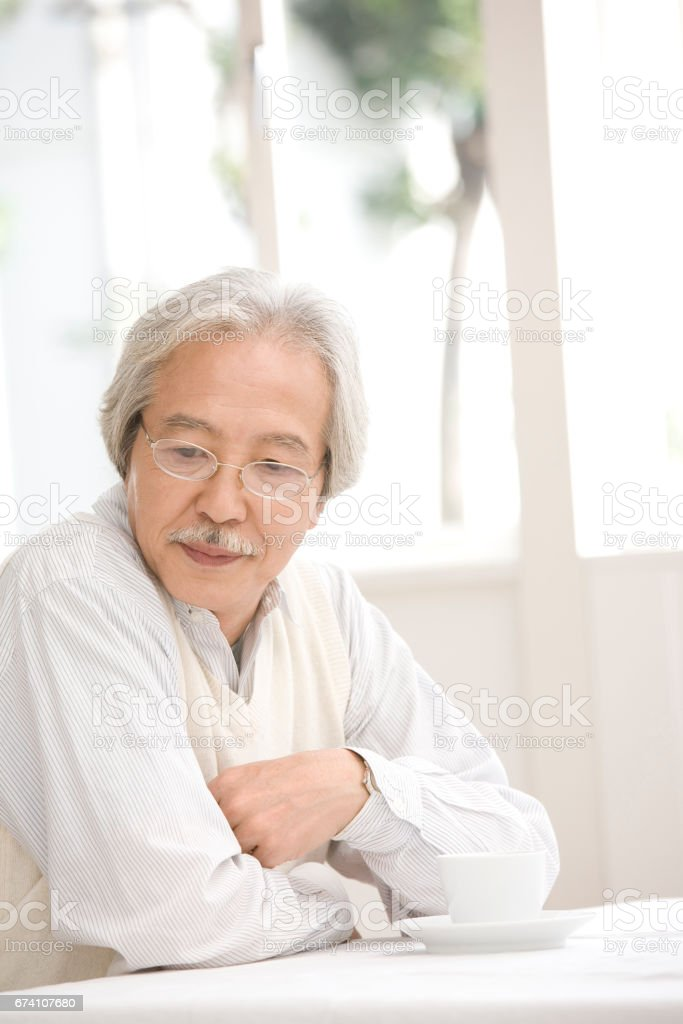 Senior men sit at tables royalty-free stock photo