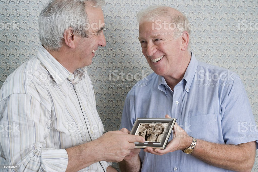Senior men with photograph 免版稅 stock photo