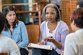 Senior mental health professional facilitates support group