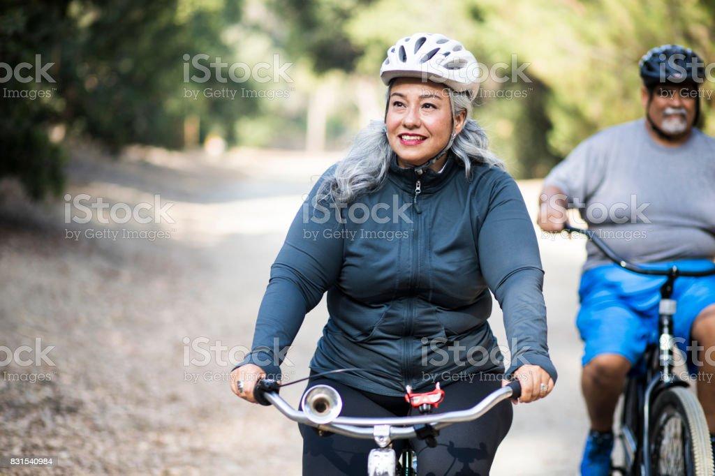 Senior Mexican Couple Biking stock photo