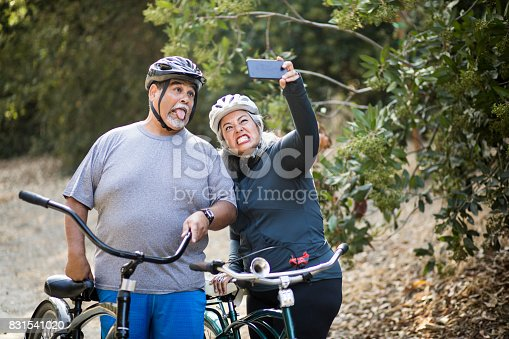 690538774istockphoto Senior Mexican Couple Biking 831541020