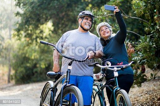 690538774istockphoto Senior Mexican Couple Biking 831541022