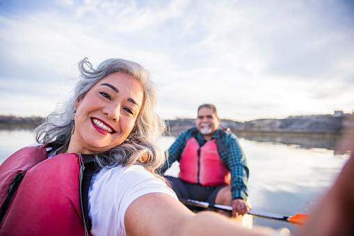 Senior Mexican Couple Kayaking Taking a Selfie