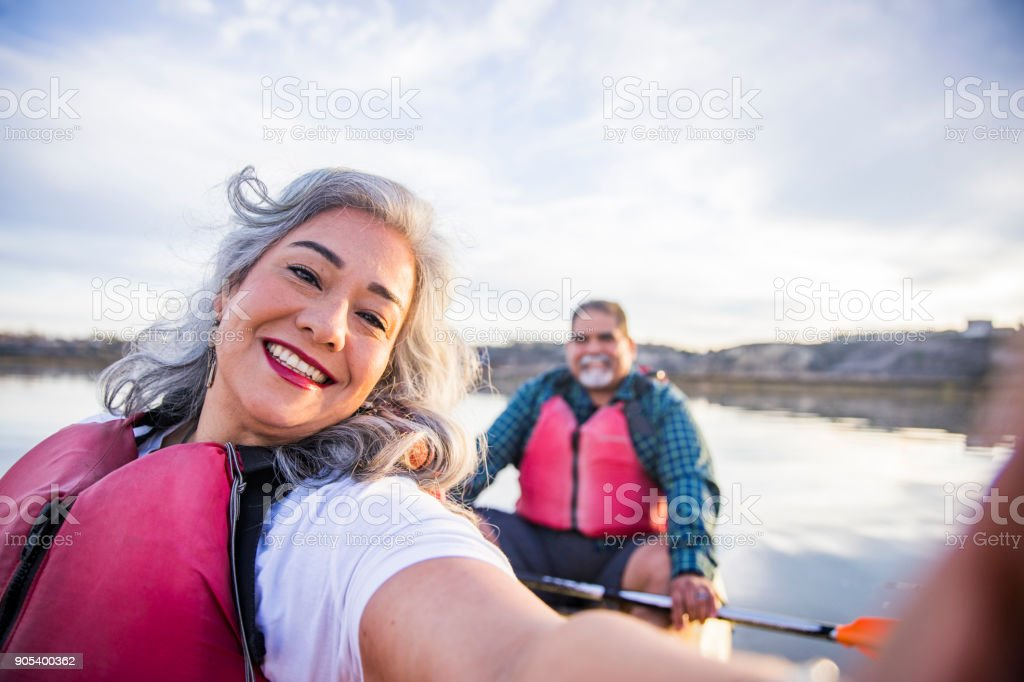 Senior Mexican Couple Kayaking Taking a Selfie stock photo