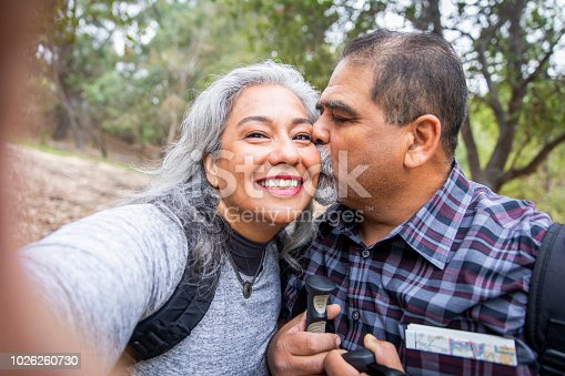 Beautiful Senior Mexican couple taking a selfie on their hike