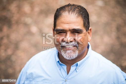 A Senior Mexican Man portrait in nature