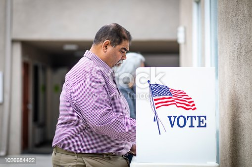 1001757174 istock photo Senior Mexican Man Voting 1026684422