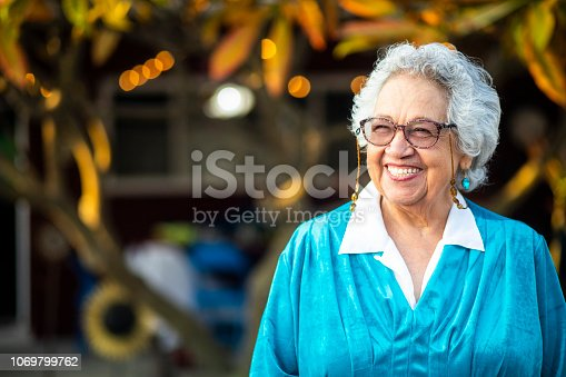 A beautiful senior mexican woman smiling.
