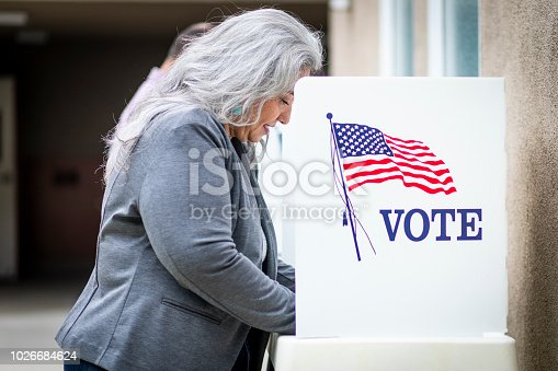 1001757174 istock photo Senior Mexican Woman Voting 1026684624
