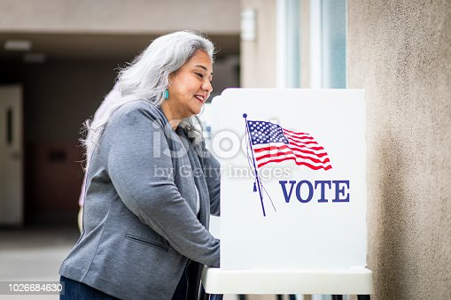 1001757174 istock photo Senior Mexican Woman Voting 1026684630