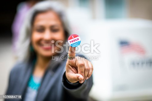 1001757174 istock photo Senior Mexican Woman Voting 1026684718