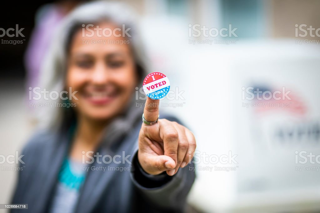 Senior Mexican Woman Voting stock photo