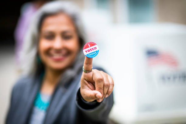 senior mexican woman voting - polling place stock pictures, royalty-free photos & images