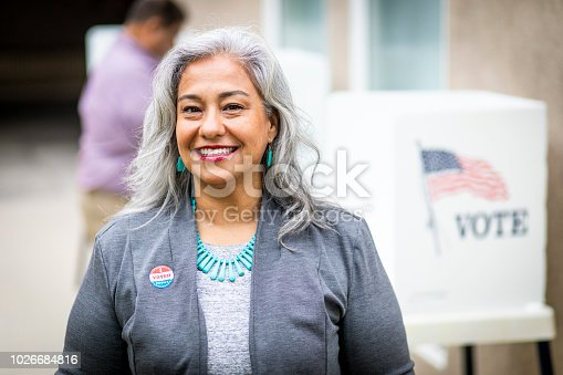 1001757174 istock photo Senior Mexican Woman Voting 1026684816