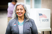 A beautiful senior mexican woman at the voting booth