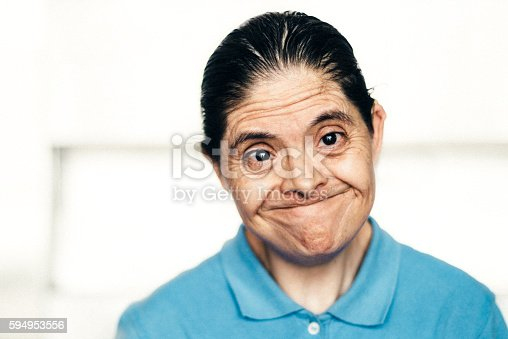 594475880istockphoto Senior Mexican woman with down syndrome 594953556