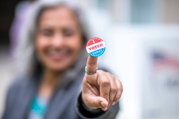 Senior Mexican Woman with I Voted Sticker stock photo
