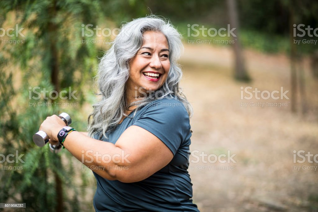 Senior Mexican Woman Working Out stock photo