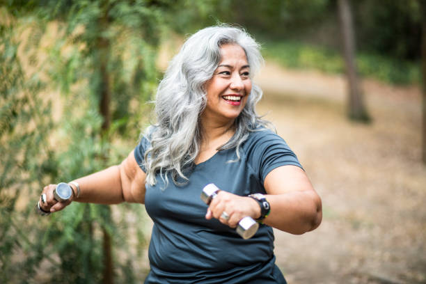 senior mexican woman working out - overweight stock pictures, royalty-free photos & images