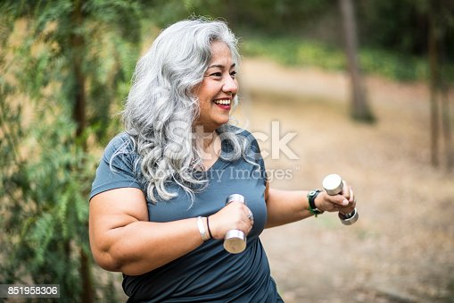 851958232 istock photo Senior Mexican Woman Working Out 851958306