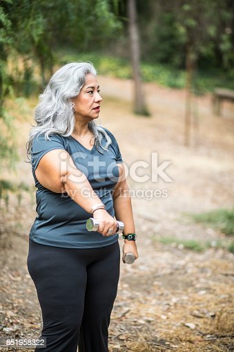 851958232 istock photo Senior Mexican Woman Working Out 851958322