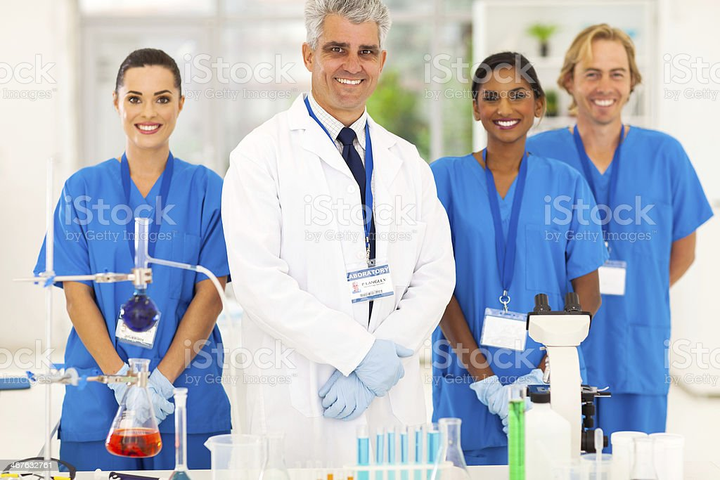 senior microbiology specialist with students stock photo