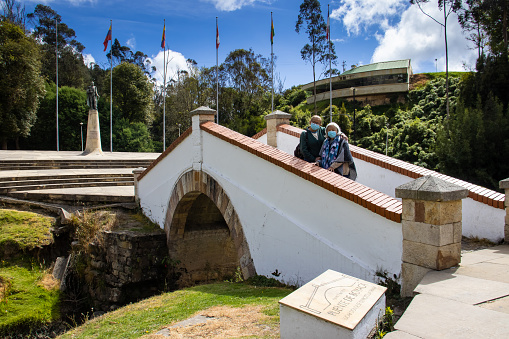 Senior mother and adult daughter traveling. The famous historic Bridge of Boyaca in Colombia. The Colombian independence Battle of Boyaca took place here on August 7, 1819.