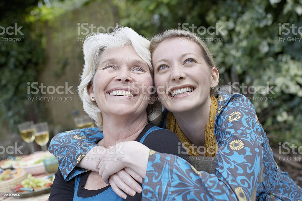 Senior mother and daughter hugging royalty-free stock photo