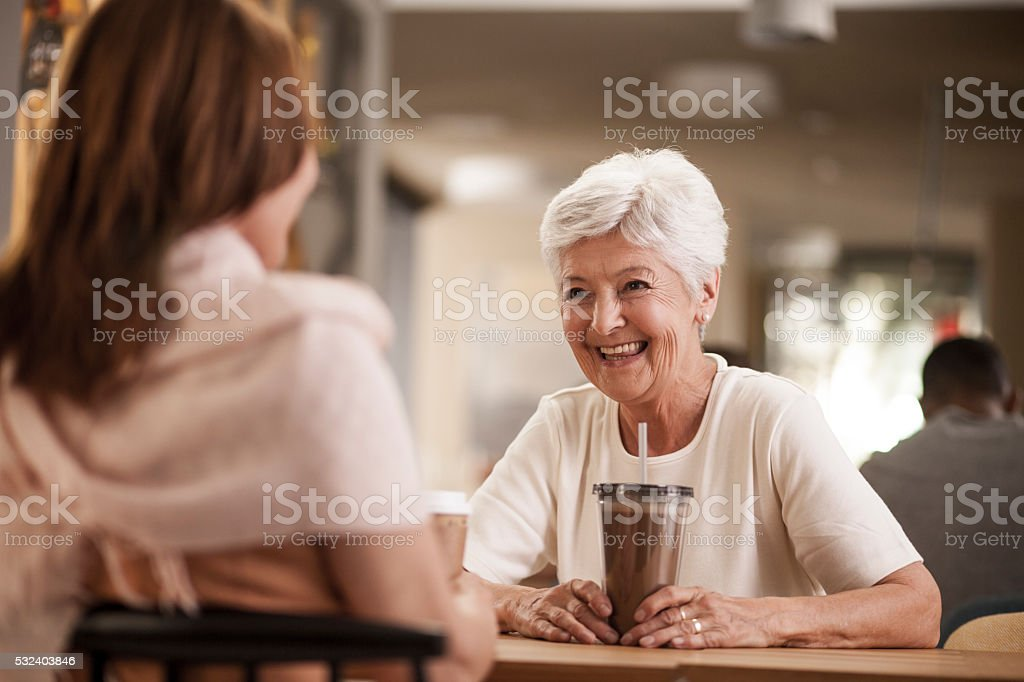 Senior mother and daughter in caffee shop stock photo