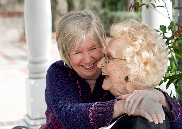 Senior mother and daughter laughing stock photo