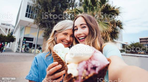 Senior mother and daughter taking a selfie while eating icecream picture id802837868?b=1&k=6&m=802837868&s=612x612&h=l2hife2jjtqdbc9zxzaj4yk7muqk5qpwddu5jze rau=